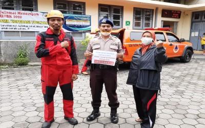 Penyemprotan Disinfektan di Lingkungan SMK Koperasi Yogyakarta